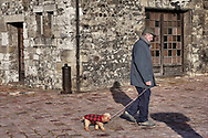 Unreliable Sightings - Hinfleur  - colour photo art by Paul Williams of a man walking his dog .<br /> <br /> Visit our REPORTAGE & STREET PEOPLE PHOTO ART PRINT COLLECTIONS for more wall art photos to browse https://funkystock.photoshelter.com/gallery-collection/People-Photo-art-Prints-by-Photographer-Paul-Williams/C0000g1LA1LacMD8