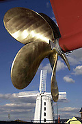The massive brass propellor contrasts with the windmill as Jeanie Johnston Replica Famine ship is launched at Blennerville, Co. Kerry, Ireland..© Picture by Don MacMonagle .Tel: 00+353+64+32833.6 PORT ROAD, KILLARNEY, CO. KERRY IRELAND