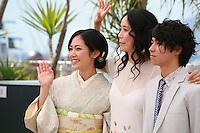 Jun Yoshinaga, Naomi Kawase and Nijiro Murakami at the photo call for the film Still The Water (Futatsume No Mado), at the 67th Cannes Film Festival, Tuesday 20th May 2014, Cannes, France.