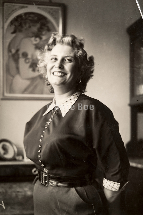 woman with a big smile posing indoors 1956