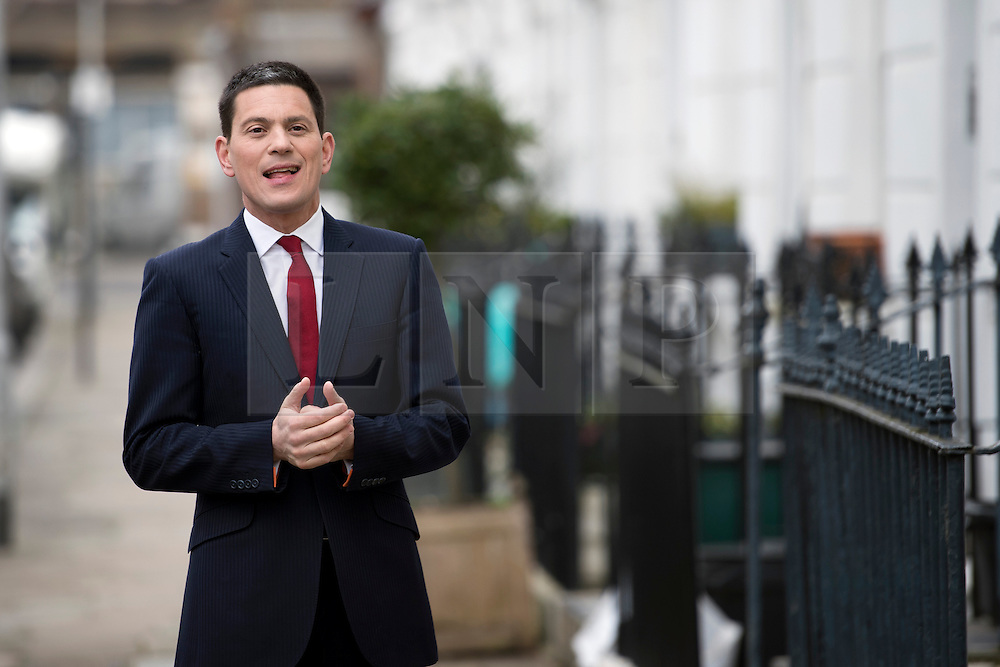 © London News Pictures. 27/03/2013 . London, UK.   Former British Foreign Secretary, David Miliband, brother of Labour Leader Ed Miliband, poses for photographers outside his London home after he resigned as the MP for South Shields to take up a role for US based charity International Rescue Committee in New York. Photo credit : Ben Cawthra/LNP