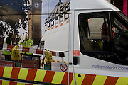 National Grid gas works van and passers-by in the busy Oxford Circus in central London.