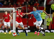 Daniel James of Manchester United runs ahead of Rodrigo of Manchester City during the Premier League match at Old Trafford, Manchester. Picture date: 8th March 2020. Picture credit should read: Darren Staples/Sportimage