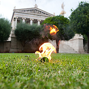 A petrol bomb on fire in the small park in front of the Academy of Athens during the the protests in Athens against the  unpopular austerity measures, June 29, 2011
