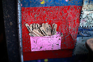 Popsicle stick bookmarks with students names on them are seen in a tornado-damaged Briarwood elementary school classroom in Oklahoma City, Oklahoma May 22, 2013.  Rescue workers with sniffer dogs picked through the ruins on Wednesday to ensure no survivors remained buried after a deadly tornado left thousands homeless and trying to salvage what was left of their belongings. Curvature of horizon in the photo is due to an ultra-wide angle lens.  REUTERS/Rick Wilking (UNITED STATES)