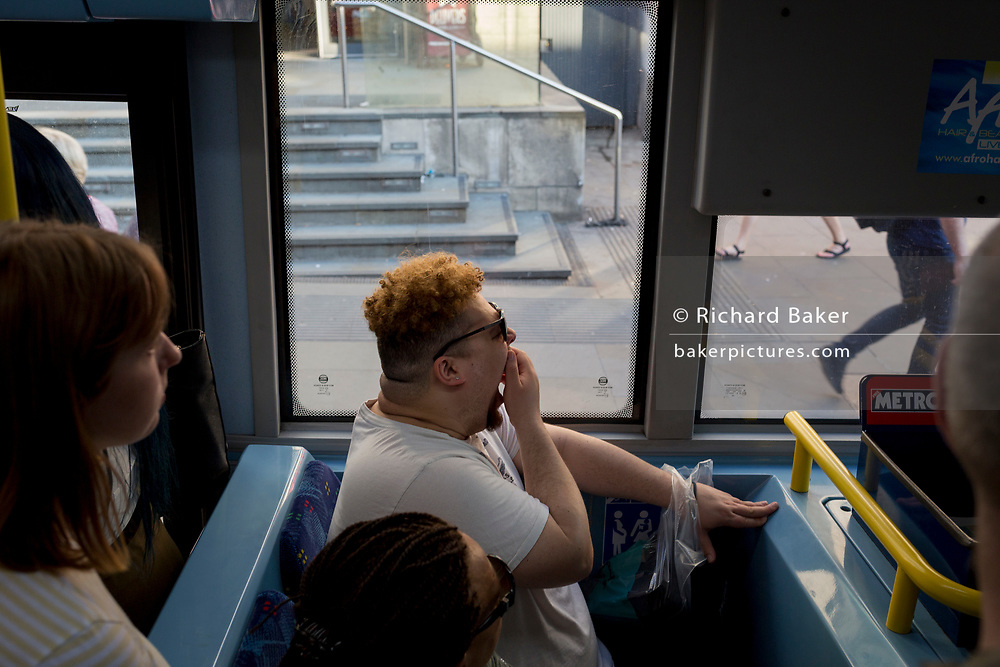 Bus passengers during the evening rush-hour, on 19th April 2018, in London, England.
