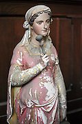 old and dilapidated religious sculptures of Mary