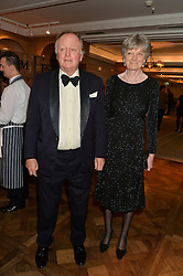ANDREW PARKER BOWLES and ROSALIND MORRISON at a party to celebrate the publication of 'Let's Eat meat' by Tom Parker Bowles held at Fortnum & Mason, Piccadilly, London on 21st October 2014.