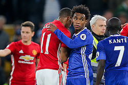 Willian commiserates Anthony Martial of Manchester United after Chelsea win 4-0 - Rogan Thomson/JMP - 23/10/2016 - FOOTBALL - Stamford Bridge Stadium - London, England - Chelsea v Manchester United - Premier League.