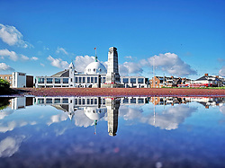 © Licensed to London News Pictures. 05/06/2019. Whitley Bay, UK. Spanish City at Whitley Bay in North Tynemouth, reflected in a rain water puddle, a clear and sunny day on the north east coast. Photo credit: Colin Scarr/LNP