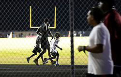 August 18, 2018 - Wellington, Florida, U.S. - Two adults were shot Friday night at a football game between Palm Beach Central and William T. Dwyer high schools, authorities said. The gunfire sent players and fans screaming and stampeding in panic during the fourth quarter of the game at Palm Beach Central High School in Wellington, Florida on August 17, 2018. (Credit Image: © Allen Eyestone/The Palm Beach Post via ZUMA Wire)