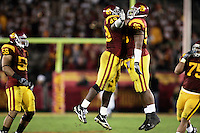 25 November 2006: Defense #49 Sedrick Ellis and Lawrence Jackson jump in the air and bump chests to celebrate a tackle.  NCAA College Football final home game of the season for the University of Southern California USC Trojans with a 44-24 victory over the University of Notre Dame Irish at the LA Memorial Coliseum.<br />