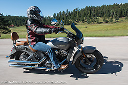 Andrea Conti on the Harley-Davidson Angels Ride to benefit the Nature Conservancy during the annual Sturgis Black Hills Motorcycle Rally.  SD, USA.  August 12, 2016.  Photography ©2016 Michael Lichter.