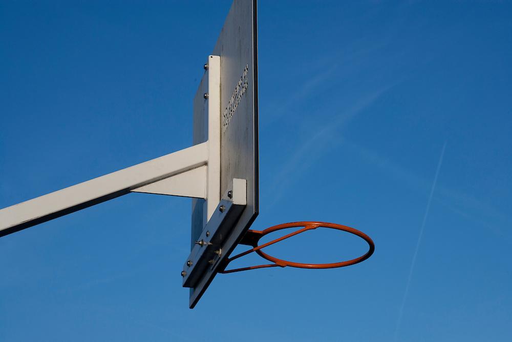 Basket Ball hoop against blue sky background
