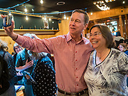 11 MAY 2019 - DAVENPORT, IOWA: JOHN HICKENLOOPER, the former Governor of Colorado, does a selfie with an Iowa Democrat after a campaign event at Baked Beer and Bread, a microbrew/bakery in Davenport. Gov. Hickenlooper met with voters in Davenport Saturday. He is campaigning in Iowa this weekend to be the Democratic party's nominee for the US Presidency. Iowa traditionally hosts the the first election event of the presidential selection cycle. The Iowa Caucuses will be on Feb. 3, 2020.          PHOTO BY JACK KURTZ