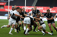 Jeff Hassler of the Ospreys © is halted by Matteo Minozzi of Zebre Rugby (no15 ) Guinness Pro14 rugby match, Ospreys v Zebre Rugby at the Liberty Stadium in Swansea, South Wales on Saturday 2nd September 2017. <br /> pic by Andrew Orchard, Andrew Orchard sports photography.