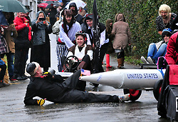 © Licensed to London News Pictures.01/01/2018<br /> SUTTON VALENCE, UK.<br /> A COMPETITOR FROM THE QUEENS HEAD TEAM ON THE GROUND AT THE START.<br /> The traditional New Years day Sutton Valence Pram Race in Kent continued this year. In its 38th year the Race was struck by tragedy last year when competitor Francis 'Titch' O' Sullivan tipped over in his spitfire pram and hit his head on the curb, he passed away a day later. A coroners court reported he was not wearing a helmet.<br />  All babies in the pram's have to wear a helmet and the pushers must have contact with the pram and the ground at all times.<br />  <br /> Photo credit: Grant Falvey/LNP