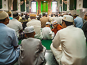 06 JULY 2016 - BANGKOK, THAILAND:  Men and boys gather for Eid services in Bang Luang Mosque in the Thonburi section of Bangkok. Eid al-Fitr is also called Feast of Breaking the Fast, the Sugar Feast, Bayram (Bajram), the Sweet Festival or Hari Raya Puasa and the Lesser Eid. It is an important Muslim religious holiday that marks the end of Ramadan, the Islamic holy month of fasting. Muslims are not allowed to fast on Eid. The holiday celebrates the conclusion of the 29 or 30 days of dawn-to-sunset fasting Muslims do during the month of Ramadan. Islam is the second largest religion in Thailand. Government sources say about 5% of Thais are Muslim, many in the Muslim community say the number is closer to 10%.       PHOTO BY JACK KURTZ