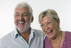 Mature couple; laughing,