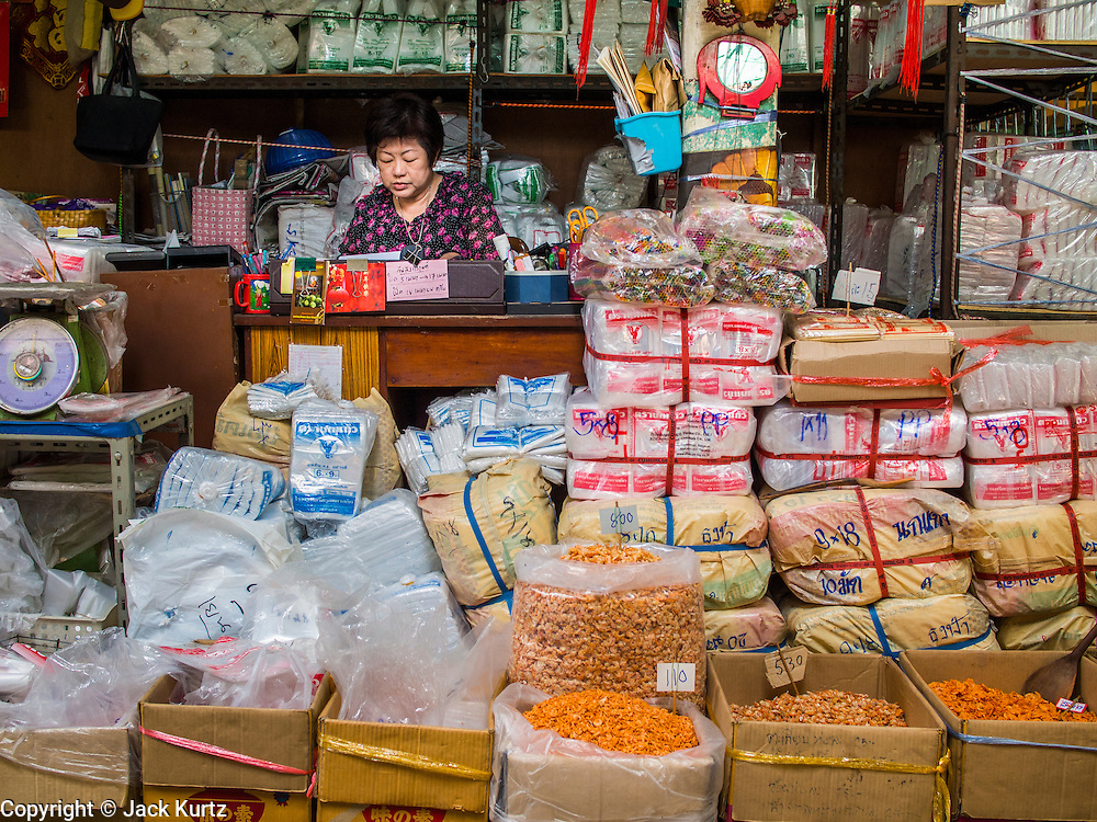 01 APRIL 2014 - BANGKOK, THAILAND:   A small shop in Tha Tien Market. Tha Tien Market is a small neighborhood fish market near Tha Tien Pier and Wat Pho. It's very close to several of Bangkok's most important tourist landmarks, including Wat Pho, Wat Arun and the Grand Palace. The market is being renovated and may be turned into a mall, which would displace the vendors in the market. Several small restaurants in the market have already closed.   PHOTO BY JACK KURTZ