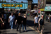 Street scene and the railway bridge on a busy summer day at Camden Market, North London. Camden Lock is a crowded hang out for young Londoners and tourists.