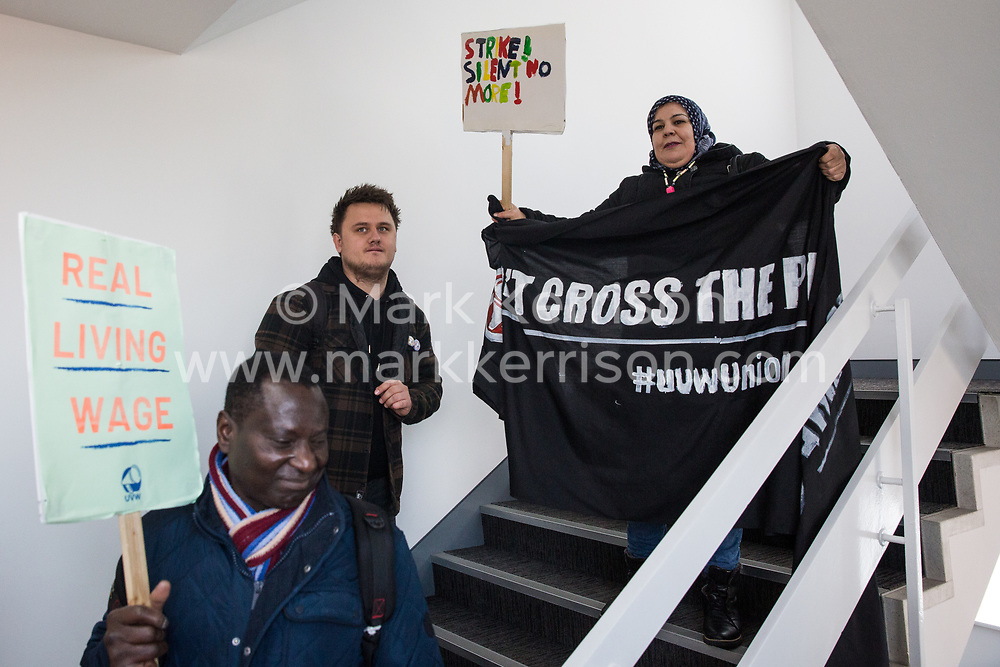 London, UK. 31 October, 2019. Low-paid and predominantly migrant University of Greenwich café workers outsourced via BaxterStorey and belonging to the United Voices of the World (UVW) trade union protest at the offices of BaxterStorey during a coordinated series of 'five strikes in one day' involving also cleaners from the Ministry of Justice, cleaners, caterers and porters from St Mary's Hospital Paddington, cleaners from ITV and Channel 4's offices and park attendants from the Royal Parks. The café workers wish to be brought in-house and given the same terms and conditions as other workers at the university.