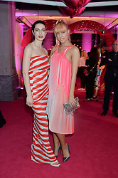 Left to right, TALI LENNOX and AMBER LE BON at The Naked Heart Foundation's Fabulous Fund Fair hosted by Natalia Vodianova and Karlie Kloss at Old Billingsgate Market, 1 Old Billingsgate Walk, London on 20th February 2016.