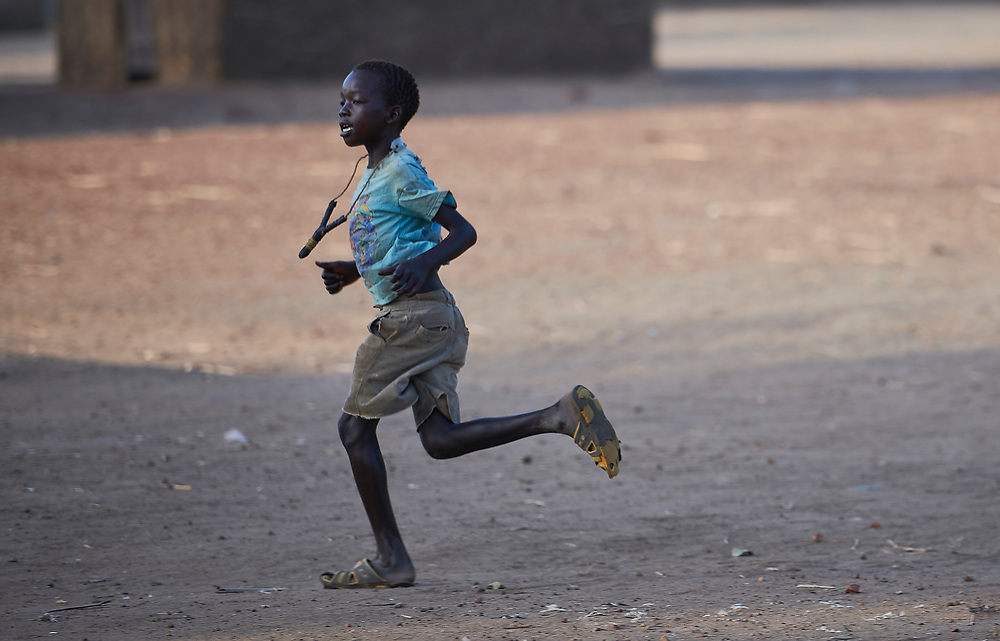 A boy runs in Bunj, a town in Maban County, South Sudan. Maban is host to four refugee camps that together shelter more than 130,000 refugees from the Blue Nile region of Sudan. Jesuit Refugee Service, with support from Misean Cara, provides educational and psycho-social services to both refugees in the camps and the host community.
