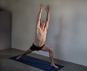 Middle aged man keeping fit with yoga on 29th December 2016, Lagrasse, France. Seniors, who often struggle with pain, joint stress, imbalance, osteoarthritis, and other physical limitations, can benefit from incorporating a yoga practice into their daily routine.