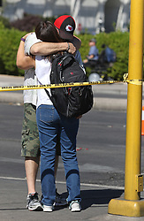 Las Vegas mass shooting survivors George Sanchez, of San Diego, and Johanna Ernst, of the San Francisco Bay area, embrace on the Las Vegas Strip Tuesday, Oct. 3, 2017, in Las Vegas. Sanchez suffered a bullet wound to his left arm Sunday evening while the couple attended the Route 91 Harvest country music festival. (Photo by Ronda Churchill/ZUMA Press)