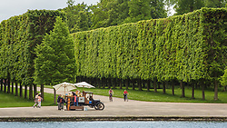 Cyclists in the gardens of Versailles outside of Paris, France. 11/05/14. Photo by Andrew Tallon