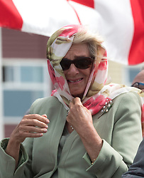 The Duchess of Cornwall holds her headscarf during a gust of wind as she attends an official welcome ceremony at Nunavut Legislative Assembly in Iqaluit, the capital city of the Canadian territory of Nunavut, at the start of their visit to Canada.
