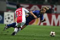 Amsterdam, 15-9-04<br />Champions League 2004-05<br />Ajax-Juventus<br />nella  foto Nedved atterrato da Obodai<br />Foto Snapshot / Graffiti