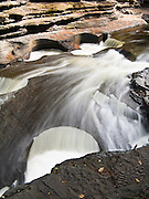 The Presque Isle River carves round potholes in Nonesuch Shale rock before flowing into Lake Superior. Porcupine Mountains Wilderness State Park, Michigan, USA.