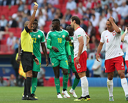 MOSCOW, June 19, 2018  The referee gives a yellow card to Grzegorz Krychowiak (2nd R) of Poland during a Group H match between Poland and Senegal at the 2018 FIFA World Cup in Moscow, Russia, June 19, 2018. (Credit Image: © Ye Pingfan/Xinhua via ZUMA Wire)
