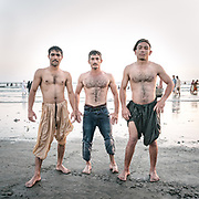 There are over 1 million Afghan refugees in Karachi. Three Afghan friends come to cool down in the Arabian Sea, at the Clifton Beach  an area very popular with locals.
