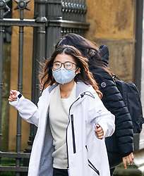 © Licensed to London News Pictures. 31/01/2020. Manchester , UK . A  woman wears a protective mask as she  walks  in Central Manchester. Two people in the same family have been diagnosed with the Coronavirus in the UK, which has killed at least 213 people in China Photo credit: Ioannis Alexopoulos /  LNP
