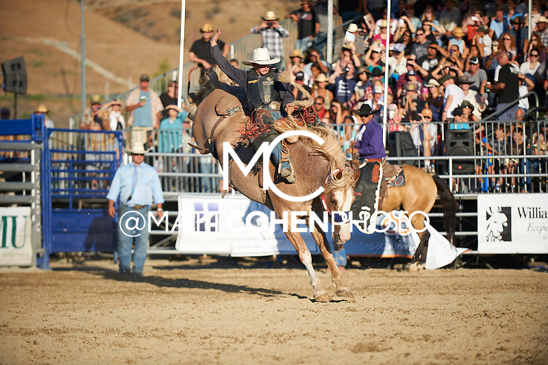 Saddle bronc rider Rusty Wright of Milford, UT takes a re-ride at the Rancho Mission Viejo Rodeo in San Juan Capistrano, CA.<br /> <br /> <br /> UNEDITED LOW-RES PREVIEW<br /> <br /> <br /> File shown may be an unedited low resolution version used as a proof only. All prints are 100% guaranteed for quality. Sizes 8x10+ come with a version for personal social media. I am currently not selling downloads for commercial/brand use.