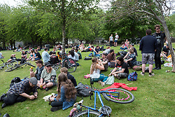 "© Licensed to London News Pictures. 25/05/2019. Bristol, UK. A ""drink-in"" protest, organised by Bristol Momentum Youth, is held in Bristol's Castle Park against fines under a Public Space Protection Orders (PSPOs) now being implemented by Bristol City Council which are used to ban alcohol drinking in certain areas. Though most of the alcohol in public bans have been in place since late 2017, they weren't actively enforced until this year when contractor 3GS took over the council contract for litter and other rules enforcement in outside spaces from previous contractor Kingdom. The PSPO rule states that: ""No person in the restricted area shall be in possession of any opened or unsealed bottle or container of alcohol"". The fines can be up to £100 and protestors say it will disproportionately affect the least well off in the community who are also likely be targeted more with the fines in the first place, and is another step in eroding the use of public space. Photo credit: Simon Chapman/LNP."