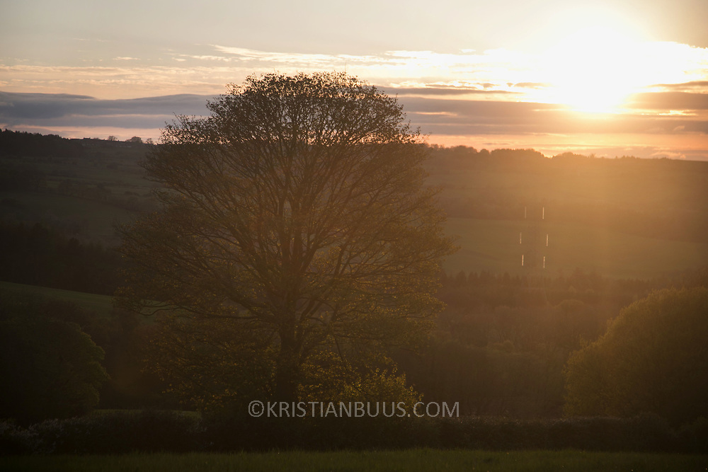 Sunset in Pont Valley ahead of the the day of protest against the mining company Banks outside Dipton in Pont Valley, County Durham, 4 May 2018.Sunset in Pont Valley ahead of the the day of protest against the mining company Banks outside Dipton in Pont Valley, County Durham, 4 May 2018. Locals have fought the open cast coal mine for thirty years and three times the local council rejected planning permissions but central government has overruled that decision and the company Banks was granted the license and rights to extract coal in early 2018. Locals have teamed up with climate campaigners and together they try to prevent the mining from going ahead. The mining will have huge implications on the local environment and further coal extraction runs agains the Paris climate agreement. A rare species of crested newt live on the land planned for mining and protectors are trying to stop the mine to save the newt.