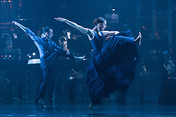 """© Licensed to London News Pictures. 12/05/2015. London, England. Pictured: Luke Ahmet and Antonia Hewitt. Rambert Dance Company perform the World Premiere of """"Dark Arteries"""" by Mark Baldwin as part of a triple bill at Sadler's Wells Theatre. Rambert perform with the Tredegar Town Band and the Rambert Orchestra from 12 to 16 May 2015. Photo credit: Bettina Strenske/LNP"""