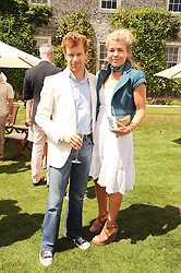 TOM & AMBER AIKENS at a luncheon hosted by Cartier for their sponsorship of the Style et Luxe part of the Goodwood Festival of Speed at Goodwood House, West Sussex on 4th July 2010.