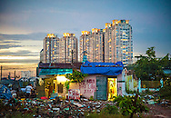 Pearl luxury apartment complex overshadows urban slums in Ho Chi Minh City, Vietnam, Southeast Asia