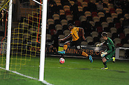 Lennel John-Lewis of Newport county shoots past Sam Hornby, the Brackley keeper to score his teams 1st goal. Emirates FA Cup 1st round replay match, Newport county v Brackley Town at Rodney Parade in Newport, South Wales onTuesday 17th November 2015. pic by Andrew Orchard, Andrew Orchard sports photography.