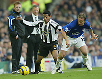 Photo: Aidan Ellis.<br /> Everton v Newcastle. The Barclays Premiership.<br /> 27/11/2005.<br /> Newcastle's Nolberto Solano battles with Everton's Andy Van Der Meyde as both managers look on