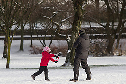 © Licensed to London News Pictures . 26/01/2013 . Salford , UK . A child throws snowballs .  People enjoy fresh overnight snow this morning (26th January 2013) in Buile Hill Park , Salford . Photo credit : Joel Goodman/LNP