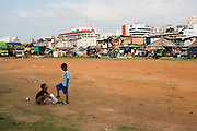 Children playing soccer at kampung Bandan, north of Jakarta.  With a population of more than 10 million people Jakarta is the largest city of Indonesia. Since it became independent in 1949 Jakarta officially became the capital city of the Republic of Indonesia.  The economic heart of Southeast Asia attracts many people from all places creating a vibrant city with a broad diversity of people living in one of the busiest cities in the world. As the city grows also issues become bigger. Inequality and poverty are one of Jakarta's challenges.