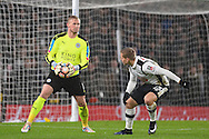 Leicester City goalkeeper Kasper Schmeichel (1) with Derby County forward Matej Vydra (23) watching the ball during the The FA Cup match between Derby County and Leicester City at the Pride Park, Derby, England on 27 January 2017. Photo by Jon Hobley.