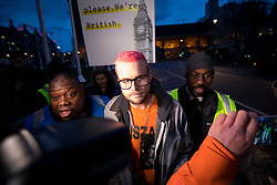 © Licensed to London News Pictures. 29/03/2018. London, UK. Christopher Wylie, the Cambridge Analytica whistleblower, leaves after speaking at the 'Rally for a Fair Vote', a demonstration on Parliament Square calling for evidence of cheating on either sides of the Brexit referendum to be brought forward. Cambridge Analytica is being investigated due to accusations of the misuse of Facebook user data to influence electoral outcomes. Photo credit : Tom Nicholson/LNP