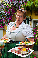 Unterloiben, Danube, Lower Austria, September 2015. Renate Graf presents her home made food. Heuriger Graf is a great place to eat and drink local wine. Austria's most spectacular section of the Danube is the dramatic stretch of river between Krems an der Donau and Melk, known as the Wachau. Here the landscape is characterised by vineyards, forested slopes, wine-producing villages and imposing fortresses at nearly every bend. The Wachau is today a Unesco World Heritage site, due to its harmonious blend of natural and cultural beauty. Photo by Frits Meyst / MeystPhoto.com